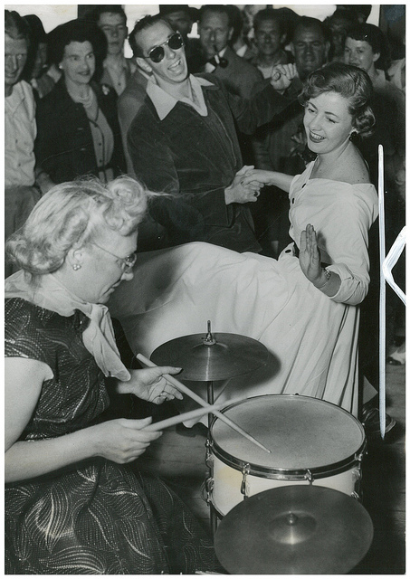 June Howarth of Canterbury and Ray Shart of Bankstown dance to the band with drummer Peg Clark of Blackheath