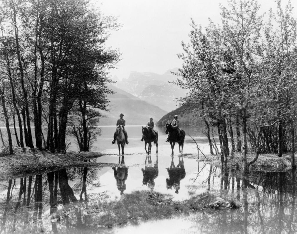 Three Riders at Cameron Bay in Waterton Lakes National Park  1928